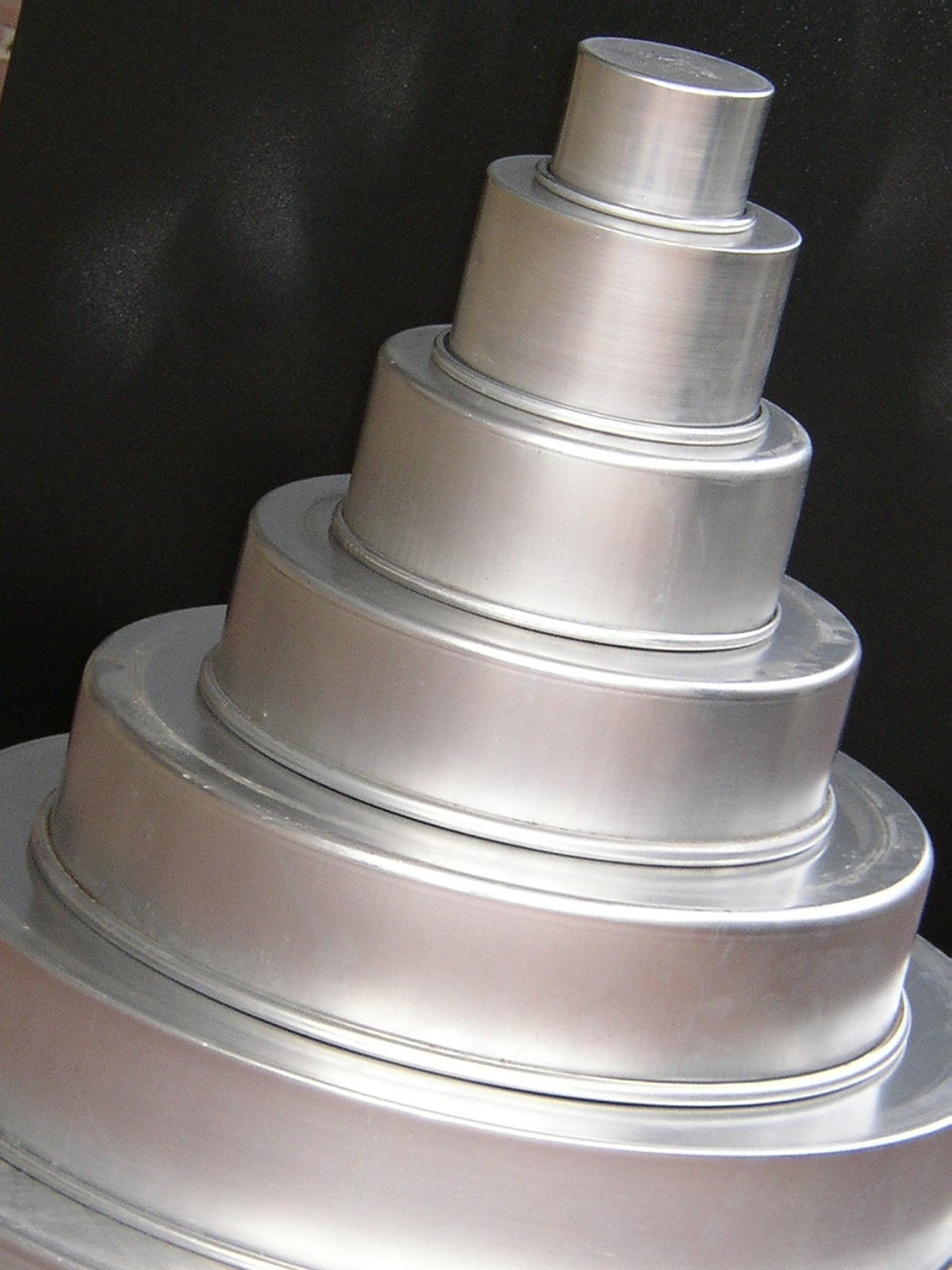 "Cake pans in sizes from 2"" to 24""."
