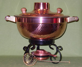 Mongolian fire pot - cook meat, fish, and vegetables in this broth filled vessel then enjoy the broth as a soup